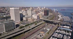 Moving in towards the Tacoma Washington skyline and waterfront. An aerial view over the highway and downtown urban core of Tacoma Washington stock video footage