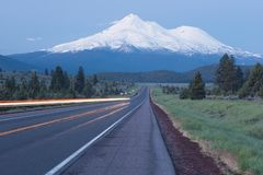 Moving track by road towards Mounts Shasta and Shastina in California, United States Highway 97 in Northern California royalty free stock photos