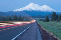 Moving track by road towards Mounts Shasta and Shastina in California, United States Highway 97 in Northern California royalty free stock image