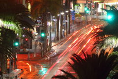 Traffic blur at night in tropical city Royalty Free Stock Images
