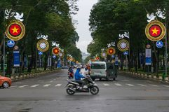 Moving traffic crossing the street in HCMC in Vietnam. Ho Chi Minh City, Vietnam - August 23, 2017: Moving traffic crossing the street in HCMC in Vietnam stock image