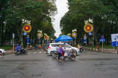 Moving traffic crossing the street during rush hour in HCMC in V. Ho Chi Minh City, Vietnam - August 23, 2017: Moving traffic crossing the street during rush stock images