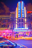Moving traffic, Illuminated Breakwater hotel with car reflection. Miami Beach, Florida USA-November 9, 2015: Moving traffic, Illuminated Breakwater hotel with Royalty Free Stock Photo