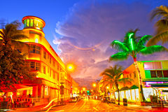 Moving traffic, Illuminated hotels and restaurants at sunset on Ocean Drive,. Miami Beach, Florida USA-November 10, 2015: Moving traffic, Illuminated hotels and Royalty Free Stock Images