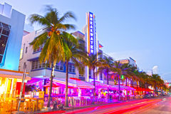Moving traffic, Illuminated hotels and restaurants at sunset on Ocean Drive. Miami Beach, Florida USA-November 10, 2015: Moving traffic, Illuminated hotels and Royalty Free Stock Photos