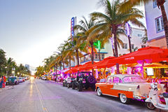 Moving traffic, Illuminated hotels and restaurants at sunset on Ocean Drive Stock Photography