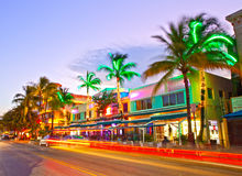 Moving traffic, Illuminated hotels and restaurants at sunset on Ocean Drive Royalty Free Stock Photography