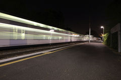 Moving Train. Blurry train stopping at a station royalty free stock photo