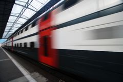Moving Train. Passing Commuter Double Deck Train Royalty Free Stock Images