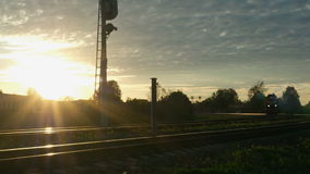 Moving train without carriages at sunset.  stock footage