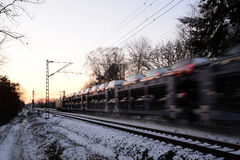 Moving train with cars Royalty Free Stock Photography