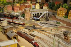 Professional model railway installation. Moving train on model railway plant, men`s toy, men`s hobbies, electric model train, expensive Hobby, Locomotive shed royalty free stock photography