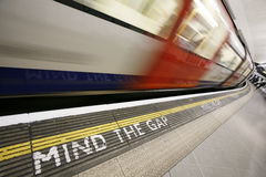 Moving train, motion blurred. Inside view of London Underground Tube Station with Moving train, motion blurred Royalty Free Stock Photos