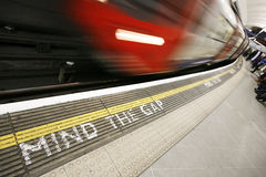 Moving train, motion blurred. Inside view of London Underground Tube Station with Moving train, motion blurred Stock Images