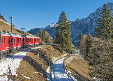 Moving Train With Mountain and Trees in Background Stock Image