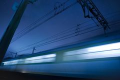 Moving train at night. Motion blur Royalty Free Stock Images