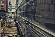 Free Moving Train On Elevated Tracks Within Buildings At The Loop, Glass And Steel Bridge Between Buildings - Chicago City Center - Lon Stock Photos - 103012013