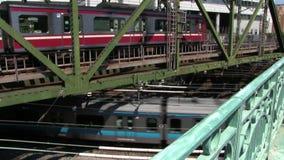 Moving train at the railway in Shinagawa Tokyo daytime stock video footage