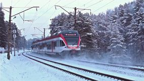 Moving train on railway at winter in dawn. Moving long  train on railway at winter at dawn stock footage
