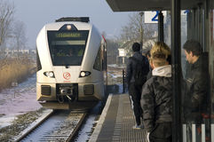 Moving train and snow on railway station Franeker Stock Image