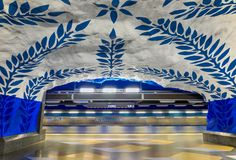 Moving train Stockholm metro or tunnelbana central station T-Centralen with intricate wall designs royalty free stock images