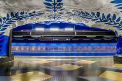Moving train Stockholm metro or tunnelbana central station T-Centralen with intricate wall designs royalty free stock photos