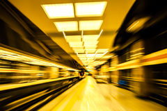 Moving train in subway station Stock Photography