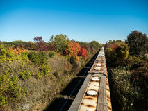 Moving Train On The Tracks. In the country autumn fall leaves colors Stock Images