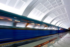 Moving train on underground station Royalty Free Stock Photo