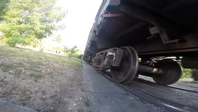Moving train wheels. Moving and stopping a freight train, wheels closeup stock video footage