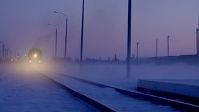 Moving train in winter night stock video
