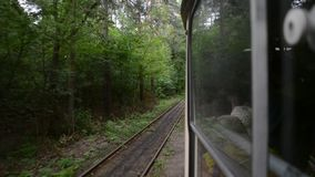 Moving tram in nature. Moving tram in green forest stock video
