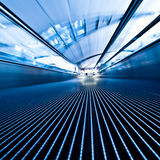 Moving travelator in office hall Stock Photos