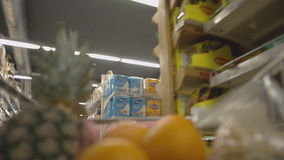 Moving trolley with groceries at the supermarket. Moving trolley with different groceries at the supermarket stock video footage
