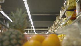 Moving trolley with groceries at the supermarket. Moving trolley with different groceries at the supermarket stock footage