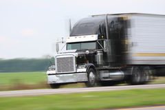 Moving truck. Cargo truck driving on road Stock Photography