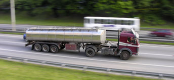 Moving truck. Truck speeding on a highway, blured background Stock Photos