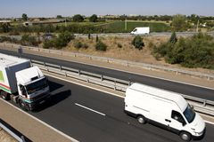 Moving trucks. Top view of moving trucks on highway Royalty Free Stock Photography