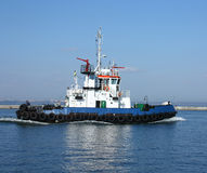Moving tugboat stock photos