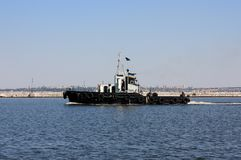 Moving tugboat Stock Images