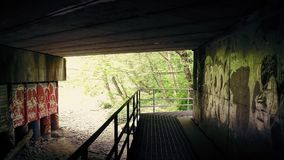 Moving Under Bridge With Graffiti On Walls stock footage
