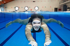 Moving underwater. Underwater picture of a young woman swimming Royalty Free Stock Photos