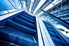 Moving up escalator Stock Photo
