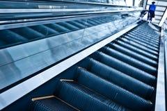 Moving up escalator Royalty Free Stock Image