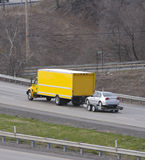 Moving Van & Car. Moving Van Towing a Car with Trailer Royalty Free Stock Photos
