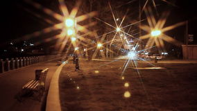 Moving vehicles on night city. In winter stock footage