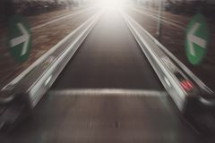 Moving waklway in the airport terminal, travel concept. Straight flat escalator. motion effect Stock Photo