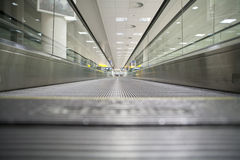 Moving walkway. In a deserted airport terminal Stock Photo