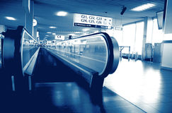Moving walkway at airport - blue tone Royalty Free Stock Photography
