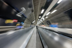 Moving walkway on tube Stock Images